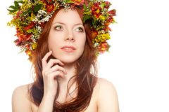 Red haired woman with flower wreath on head Stock Images