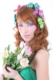 Red-haired woman with flowers Stock Images