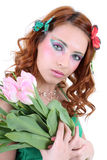 Red-haired woman with flowers Royalty Free Stock Images