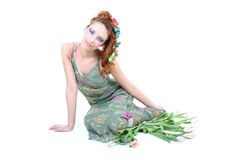 Red-haired woman with flowers and butterflies Stock Photos