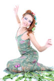 Red-haired woman with flowers and butterflies Royalty Free Stock Photography