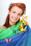 Red-haired woman with flowers and butterflies Royalty Free Stock Photo