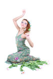 Red-haired woman with flowers sitting Stock Photography