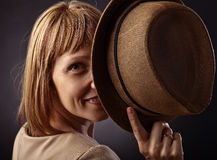 Red-haired woman with  hat Stock Image