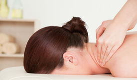 Red-haired woman having a massage Stock Image