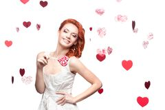 Red-haired woman holding lollipop Royalty Free Stock Photos