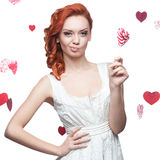 Red-haired woman holding lollipop Royalty Free Stock Photo