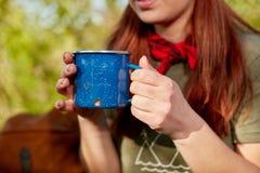 Woman holding metal mug royalty free stock photo
