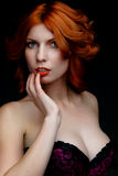 Red-haired woman in lingerie Stock Photo