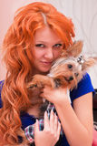 Red-haired woman and little dog Royalty Free Stock Images
