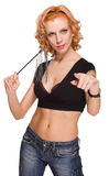Red haired woman with little whip on white Royalty Free Stock Image