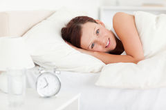 Red-haired woman lying in bed Stock Images