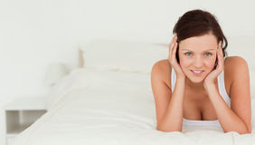 Red-haired woman lying on her bed Stock Photo