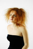 Red-haired woman with make-up and backcombing Royalty Free Stock Photos