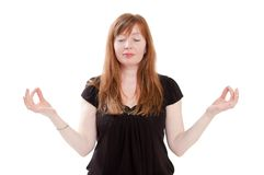 Red-haired woman meditating Stock Photography