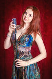 Red-haired woman with microphone Royalty Free Stock Photo