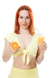 Red-haired woman with oranges and juice. On a white background Stock Image