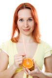 Red-haired woman with oranges and juice. On a white background Royalty Free Stock Photo
