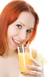 Red-haired woman with oranges juice Royalty Free Stock Photos