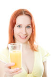 Red-haired woman with oranges juice. On a white background Royalty Free Stock Photos