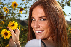Red Haired Woman Outdoors in a Sunflower Field Royalty Free Stock Photo