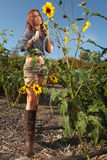 Red Haired Woman Outdoors in a Sunflower Field Royalty Free Stock Images