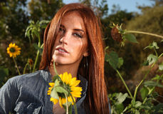 Red Haired Woman Outdoors in a Sunflower Field Royalty Free Stock Photos