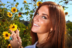 Red Haired Woman Outdoors in a Sunflower Field Stock Image