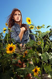 Red Haired Woman Outdoors in a Sunflower Field Stock Photos