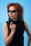 Red haired woman with pistol Royalty Free Stock Photos