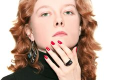 Red-haired woman portrait. Portrait of red-haired woman with purpule ring and earrings Stock Photo