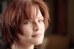 Red-haired woman portrait. Thoughtful red haired woman portrait - blurred background Stock Photo