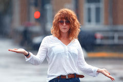 Red-haired woman in the rain. Portrait of red-haired woman in the rain Royalty Free Stock Images