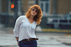 Red-haired woman in the rain Royalty Free Stock Photo