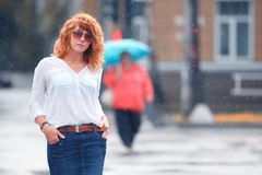 Red-haired woman in the rain. Portrait of red-haired woman in the rain Royalty Free Stock Photography