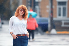 Red-haired woman in the rain. Portrait of red-haired woman in the rain Royalty Free Stock Photo