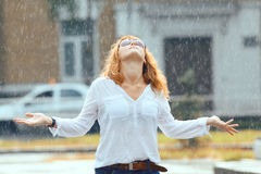 Red-haired woman in the rain. Portrait of red-haired woman in the rain Stock Image