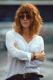 Red-haired woman in the rain. Portrait of red-haired woman in the rain Stock Photography