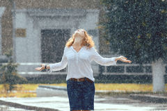 Red-haired woman in the rain Stock Images