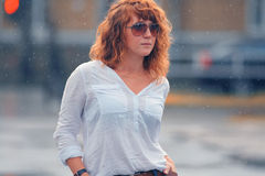 Red-haired woman in the rain. Portrait of red-haired woman in the rain Stock Photos
