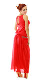Red haired woman in red dress Stock Photos
