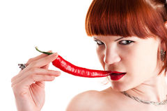Red-haired woman with red pepper Royalty Free Stock Photos