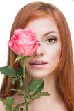Red-haired woman with a rose Royalty Free Stock Photography