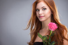 Red-haired woman with a rose Stock Photos
