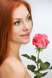 Red-haired woman with a rose Stock Image