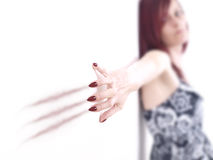Red Haired Woman Scratching Nails Along Wall Royalty Free Stock Photos