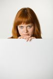 Red haired woman with sign Stock Photo