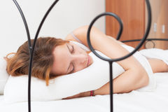 Red-haired woman sleeping on white pillow in bed Stock Images