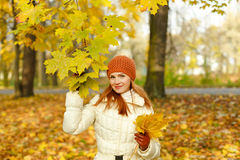 Red-haired woman smiling happy autumn Royalty Free Stock Photo