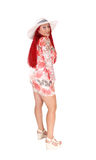 Red haired woman standing from back. Stock Photos